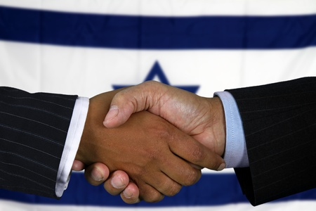 Business team shaking hands in front of the flag photo