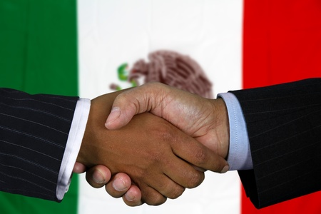presidents': Business team shaking hands in front of the flag