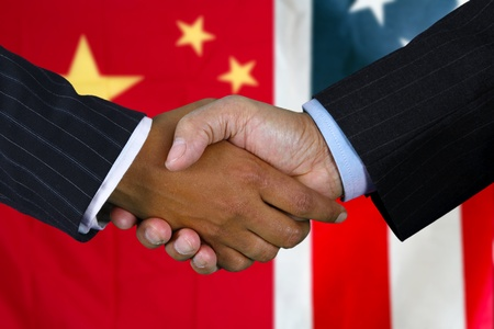 Business team shaking hands in front of the flag Stock Photo - 13144240