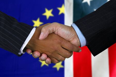 foreign: Business team shaking hands in front of the flag