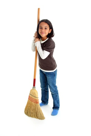 Girl cleaning the house with a broom Reklamní fotografie - 13138754