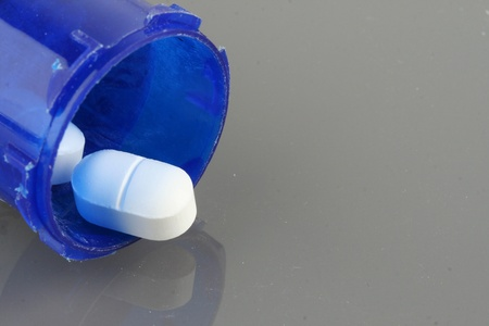 Pills with a pill bottle photo