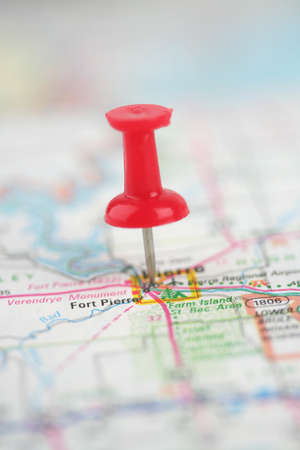 Push pin stuck in a map  photo