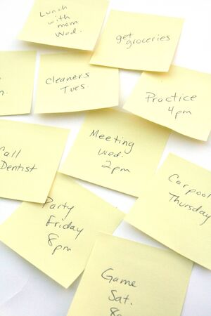 Yellow notes set to remind someone of tasks to do photo