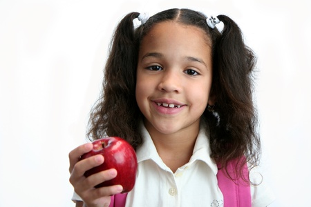7 8 years: Child giving apple to her teacher Stock Photo