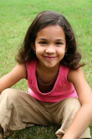 latin child: Young girl outside Stock Photo