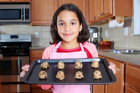 Girl baking chocolate chip cookies in the kitchen