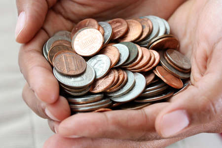 Pile of coins sitting in a womans hand photo