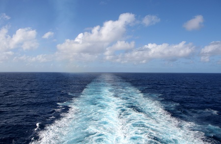 Wake from a cruise ship and the sky photo