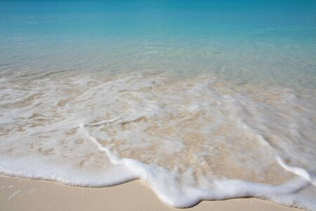 Crystal clear beach with nice blue water photo