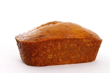 Single Banana Bread Loaf op een witte achtergrond Stockfoto