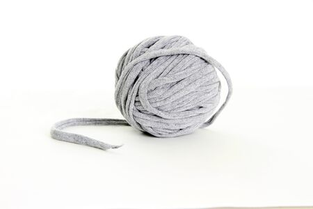 darn: Homemade Ball of Yarn on a White Background