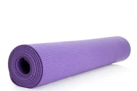 Rolled Up Yoga Mat on a White Background Stock Photo