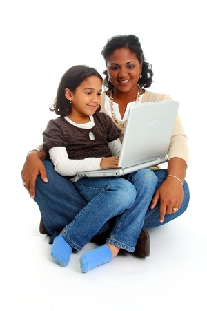 Minority woman and her daughter on white background photo