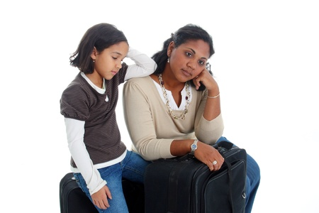 Woman and daughter with their suitcases ready to travel photo