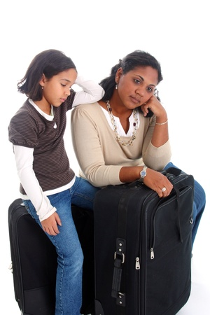 Woman and daughter with their suitcases ready to travel Imagens
