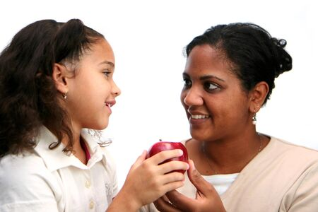 Child giving apple to her teacher Stock Photo - 13164004