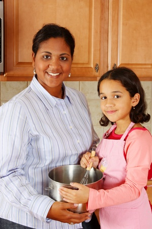 Girl and mother cooking in the kitchen