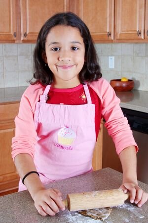 chip and pin: Girl baking chocolate chip cookies in the kitchen