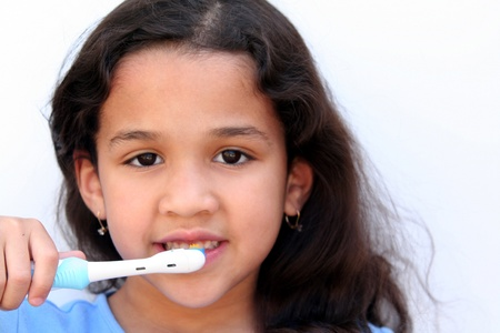 tooth decay: Young girl is brushing her teeth in bathroom