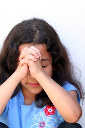 Young girl on white background who is thinking or praying Stock Photo - 13164112