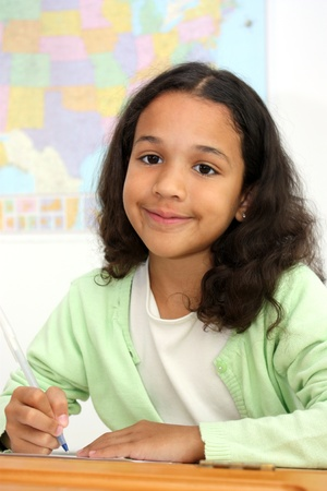 Student in a classroom at elementary school Stock Photo