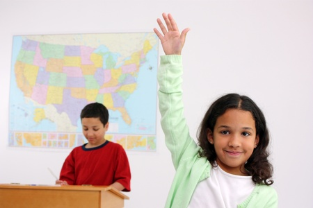 Students in a classroom at elementary school Stock Photo