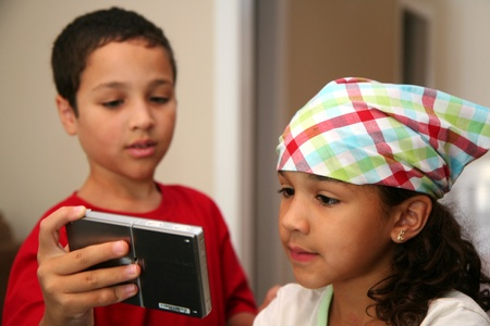 bandana girl: Girl with a bandana on with her brother