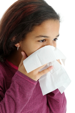 A young girl with tissue and a cold photo