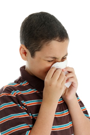 tween boy: Picture of a child sneezing on white background