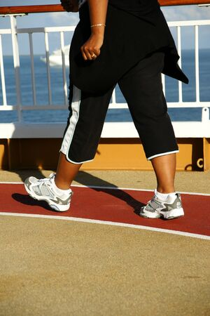 jogging track: Woman walking on a cruise ship Stock Photo