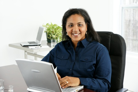 Businesswoman in her office Stock Photo - 13164289