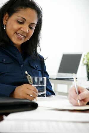 Businesswoman in her office Stock Photo - 13164233