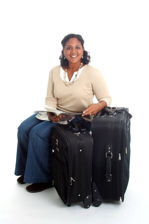 Woman with her suitcases ready to travel photo