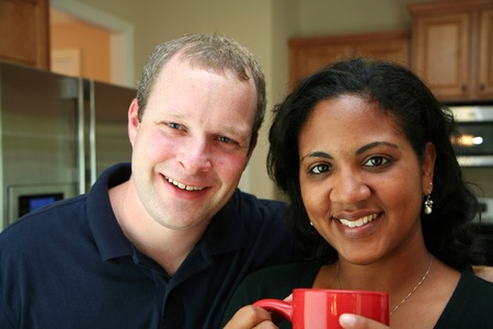 interracial love: Interracial family in the kitchen Stock Photo