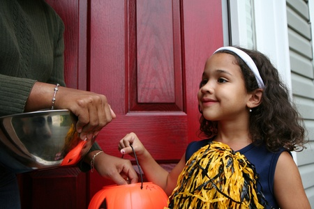 trick or treating: A girl dressed up to go trick or treating