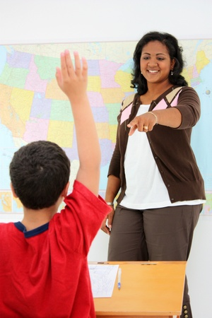 Teacher and student in a classroom at school Stock Photo - 13597898