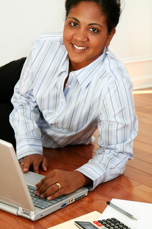 Minority woman working from home photo