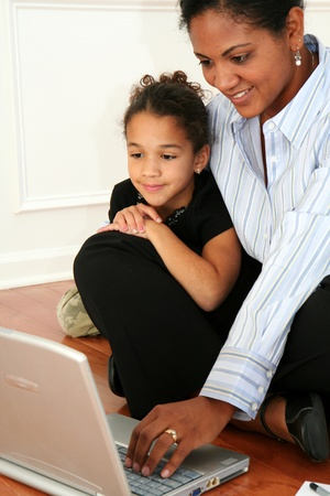 Woman and daughter on the computer photo
