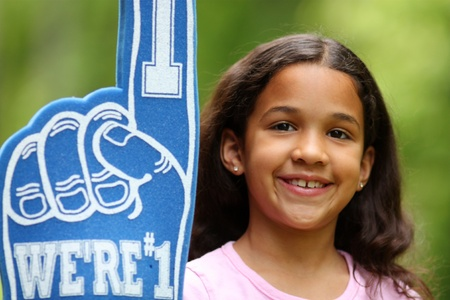 Young girl who is a fan of a sports team photo