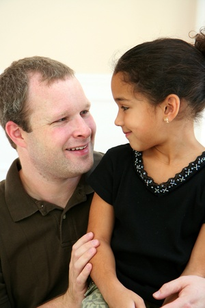 interracial love: Father with Daughter smiling