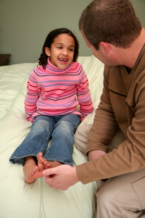 tickling: Dad tickles his daughter before she goes to bed