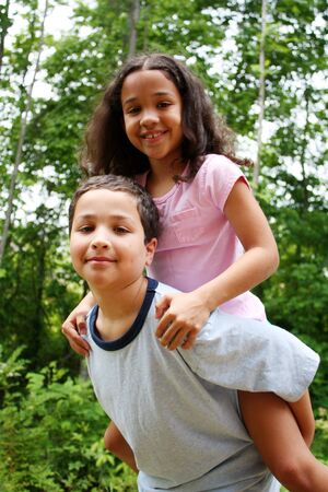 Brother and Sister giving a piggyback ride Stock Photo - 13598138