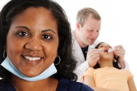 Nurse with dentist and patient on white background photo