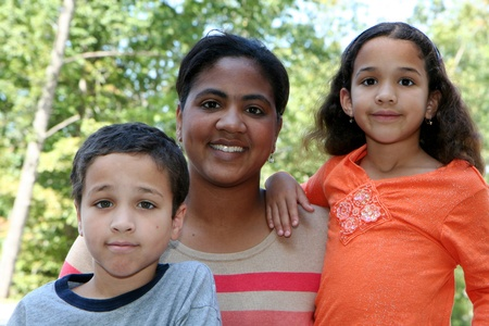 interracial relationships: A mother with her young children of a mixed race family Stock Photo