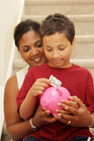 Family Holding Piggy Bank With Their Savings