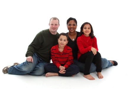 interracial family: Young mixed race family on a white background