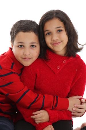 女の子と男の子の白い背景に対して一緒に 写真素材