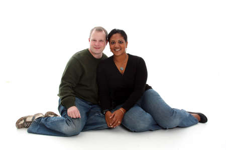 interracial marriage: Young mixed race couple on a white background