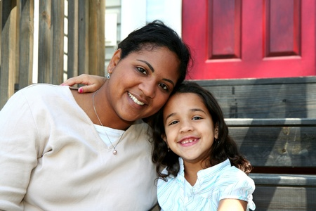 mixed race family: A mixed race mother and daughter
